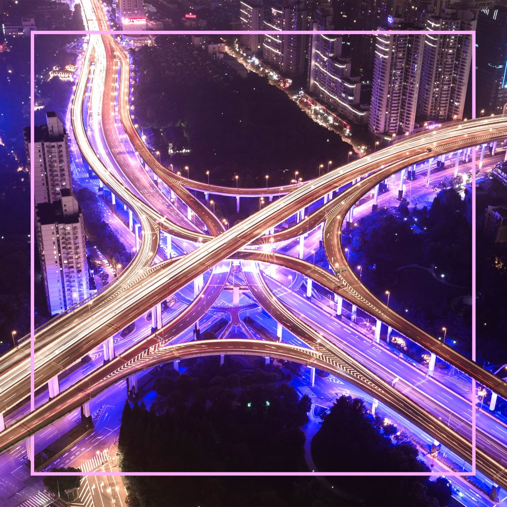 up above view of a complex highway system at night with pretty lights