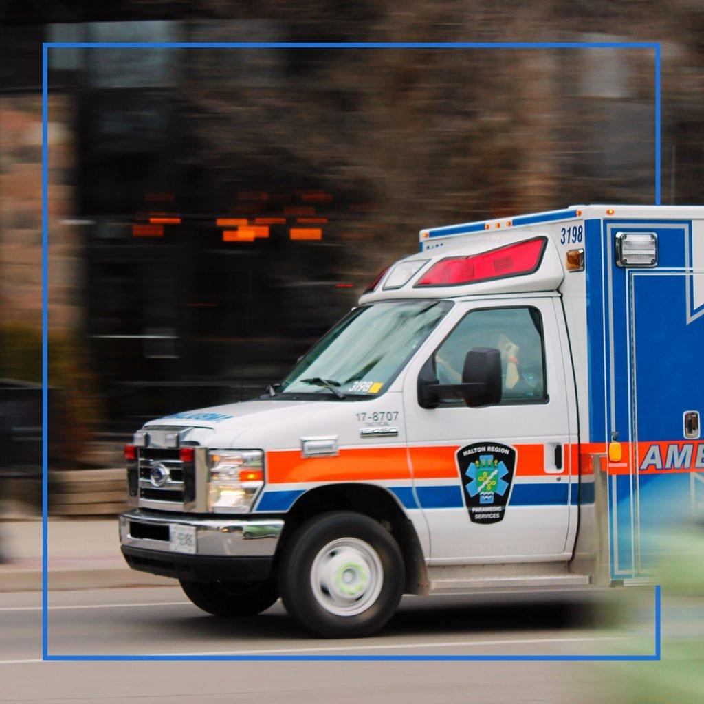 Ambulance driving through a city