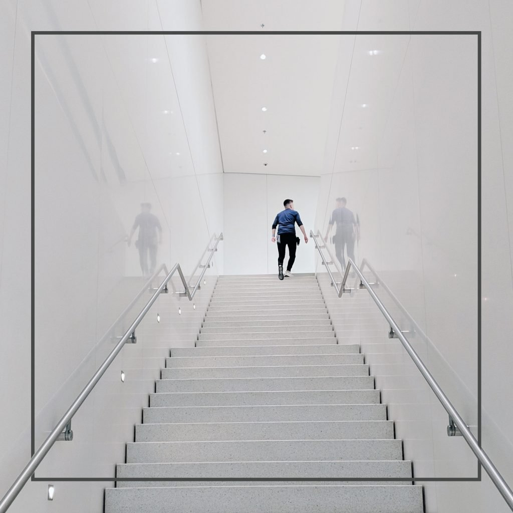 Person walking up stair case