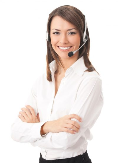 Women smiling while wearing a headset